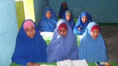 Girls are encouraged to stay silent, look down and cover mouth in schools.